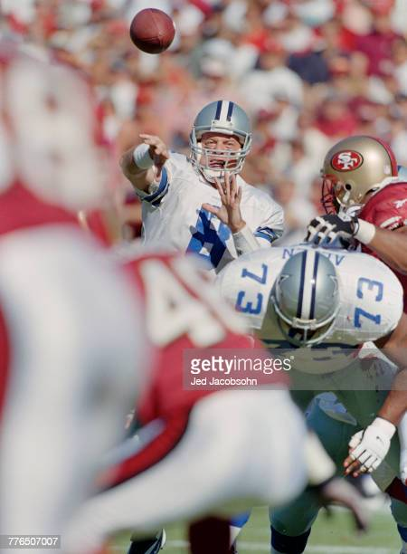 Troy Aikman Quarterback for the Dallas Cowboys throws the ball downfield during the National Football Conference West game against the San Francisco...
