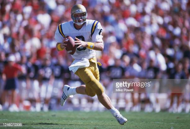 Troy Aikman, Quarterback for the University of California, Los Angeles UCLA Bruins runs the ball during the NCAA Pac-10 college football game against...