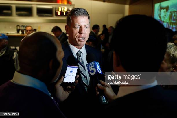 Troy Aikman speaks to the media after a press conference introducing Chip Kelly as the new UCLA Football Head Coach on November 27, 2017 in Westwood,...
