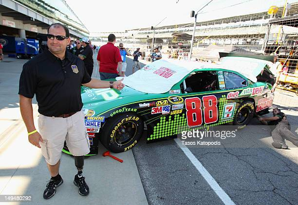 "Troy Alabama Fire Lieutenant Curtiss Shaver winner of Crown Royal's ""Your Hero's Name Here"" programposes in the pit with the Dale Earnhardt Jr #88..."