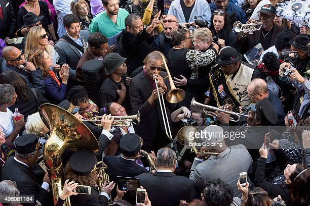 Troy Andrews aka Trombone Shorty Preservation Hall Jazz Band Sam Williams of Big Sam's Funky Nation and other musicians play in the street outside at...