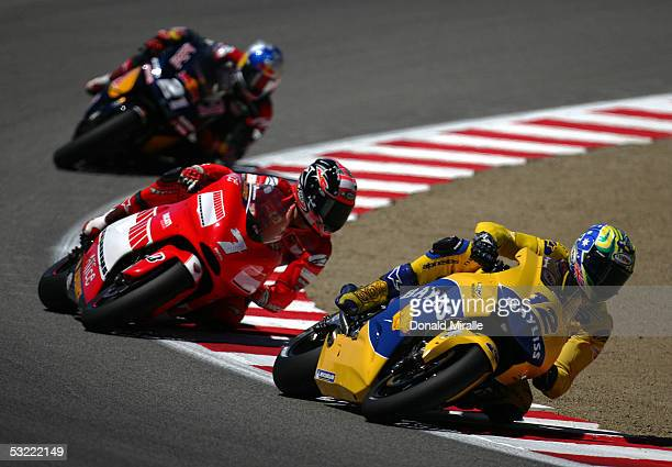 Troy Bayliss of Australia on his Honda Pons Carlos Checa of Spain on his Team Ducati and John Hopkins of the USA on his Red Bull Suzuki race for...
