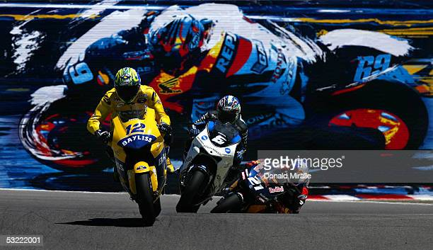 Troy Bayliss of Australia on his Honda Pons Makoto Tamada of Japan on his Konica Minolta Honda and John Hopkins of the USA on his Red Bull Suzuki...
