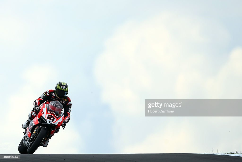 Troy Bayliss of Australia rides the #21 Aruba.it Racing-Ductati Superbike Team Ducati Panigale R during race two of the World Superbikes World Championship Australian Round at Phillip Island Grand Prix Circuit on February 22, 2015 in Phillip Island, Australia.
