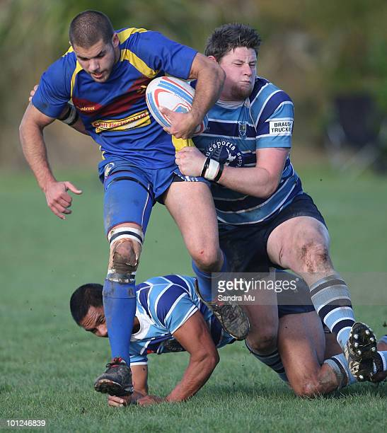Troy Becroft of the Hornets is tackled during the Fox Memorial Championship match between the Otahuhu Leopards and Howick Hornets at Paparoa Park May...
