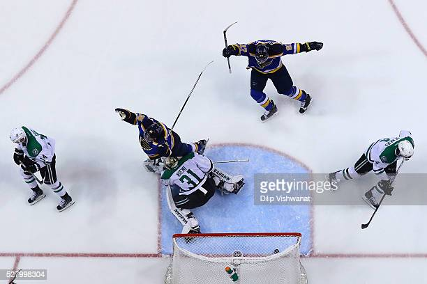 Troy Brouwer and Alex Pietrangelo of the St Louis Blues celebrate after Brouwer scored a goal against Antti Niemi of the Dallas Stars in Game Three...