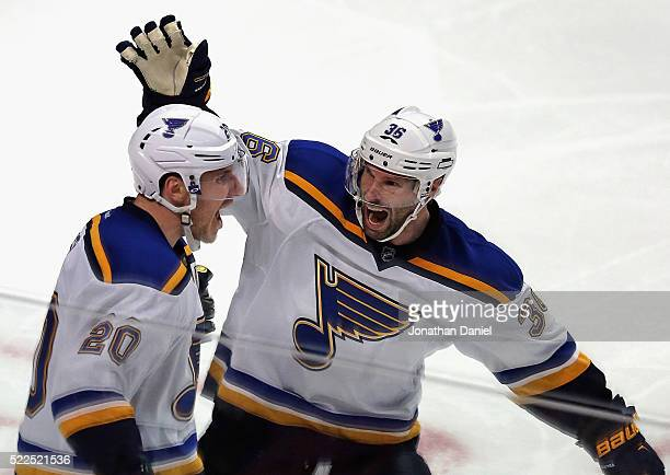 Troy Brouwer and Alexander Steen of the St. Louis Blues celebrate Steen's third period goal against the Chicago Blackhawks in Game Four of the...