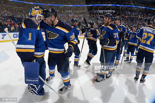 Troy Brouwer congratulates Brian Elliott of the St Louis Blues after beating the Colorado Avalanche at the Scottrade Center on March 29 2016 in St...