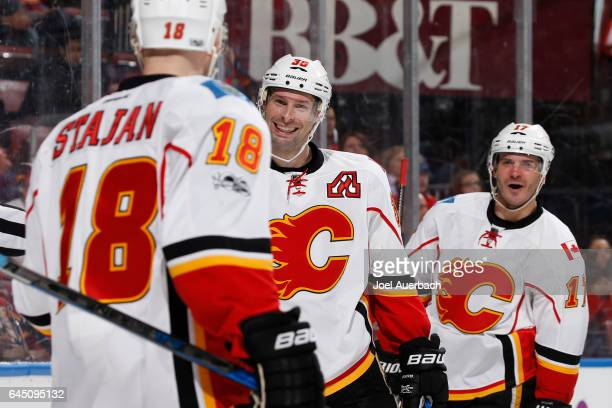 Troy Brouwer of the Calgary Flames celebrates his second period goal against the Florida Panthers with Lance Bouma and Matt Stajan at the BBT Center...