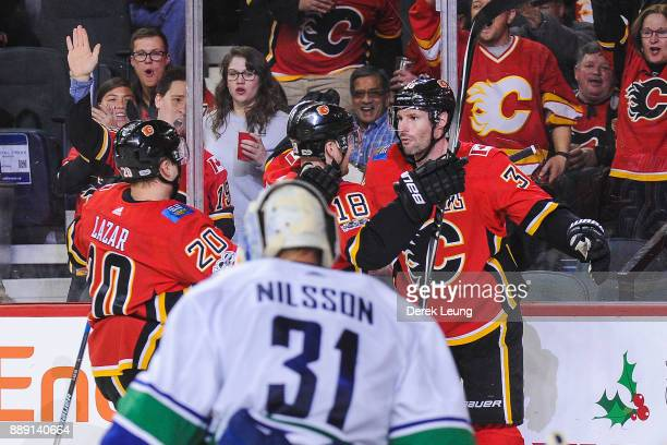 Troy Brouwer of the Calgary Flames celebrates with his teammates after scoring against the Vancouver Canucks during an NHL game at Scotiabank...