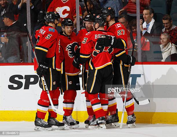 Troy Brouwer of the Calgary Flames celebrates with teammates after a goal against the Carolina Hurricanes at Scotiabank Saddledome on October 20 2016...