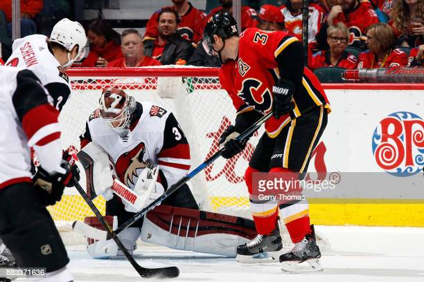 Troy Brouwer of the Calgary Flames looks for a rebound after a save by Scott Wedgewood of the Arizona Coyotes during an NHL game on November 30 2017...
