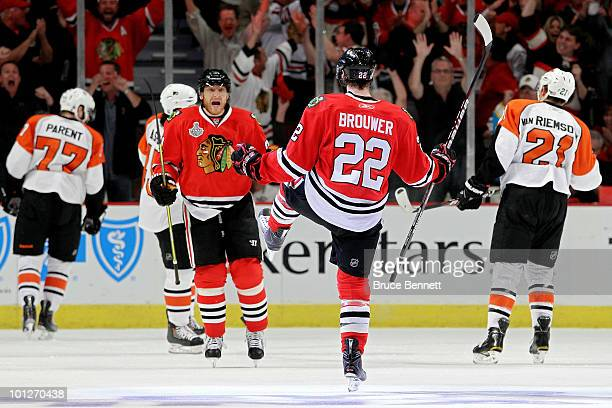 Troy Brouwer of the Chicago Blackhawks celebrates after scoring a goal in the first period with teammate Marian Hossa against the Philadelphia Flyers...