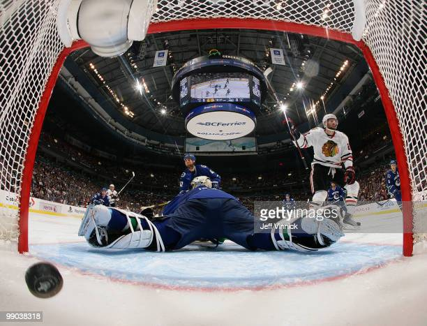 Troy Brouwer of the Chicago Blackhawks celebrates after scoring on goalie Roberto Luongo of the Vancouver Canucks in Game 6 of the Western Conference...