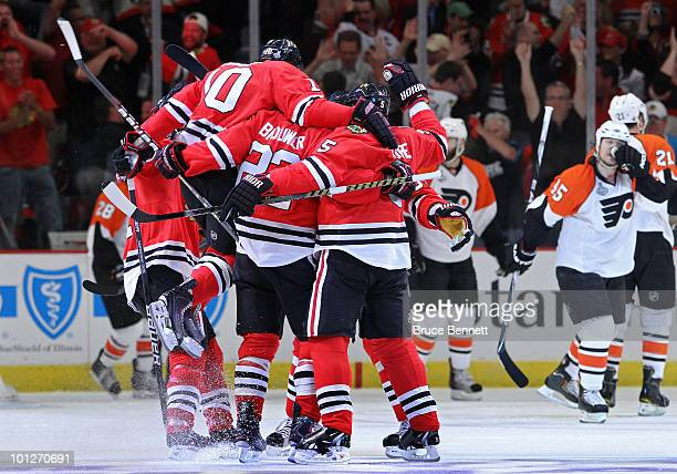 Troy Brouwer of the Chicago Blackhawks celebrates with his teammates after scoring a goal in the first period against the Philadelphia Flyers in Game...