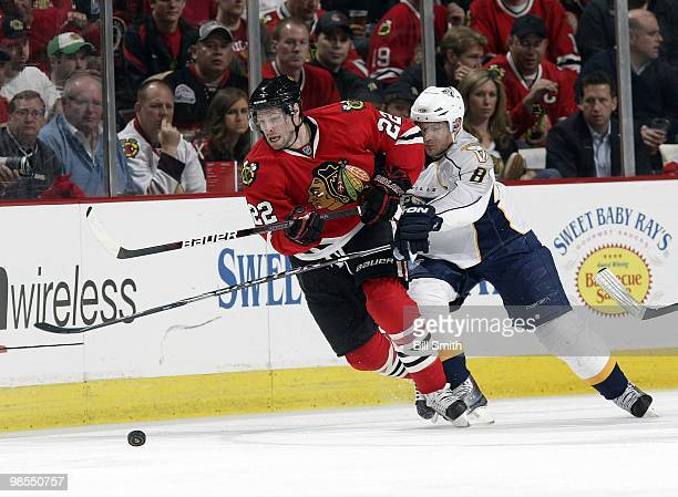 Troy Brouwer of the Chicago Blackhawks chases after the puck as Kevin Klein of the Nashville Predators pushes from behind, at Game One of the Western...