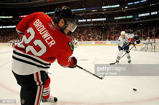 Troy Brouwer of the Chicago Blackhawks fires a shot at Sami Salo and Roberto Luongo of the Vancouver Canucks in Game One of the Western Conference...