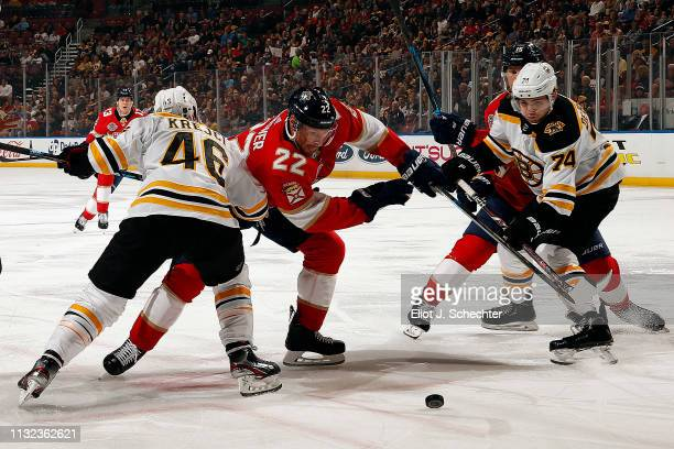 Troy Brouwer of the Florida Panthers faces off against David Krejci of the Boston Bruins at the BBT Center on March 23 2019 in Sunrise Florida