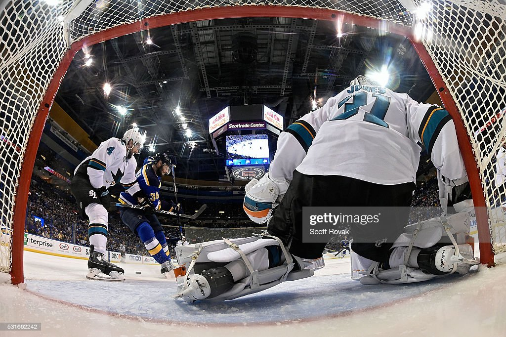 Troy Brouwer #36 of the St. Louis Blues and Brenden Dillon #4 of the San Jose Sharks battle for the puck as Martin Jones #31 defends the net in Game One of the Western Conference Final during the 2016 NHL Stanley Cup Playoffs at the Scottrade Center on May 15, 2016 in St. Louis, Missouri.