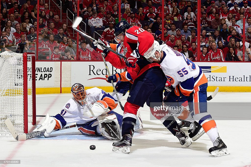 Troy Brouwer #20 of the Washington Capitals and Johnny Boychuk #55 of the New York Islanders battle for the puck in front of the net during the second period in Game Two of the Eastern Conference Quarterfinals during the 2015 NHL Stanley Cup Playoffs at Verizon Center on April 17, 2015 in Washington, DC.