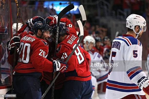Troy Brouwer of the Washington Capitals and teammates surround Andre Burakovsky after he scored the gamewinning goal against the New York Rangers...