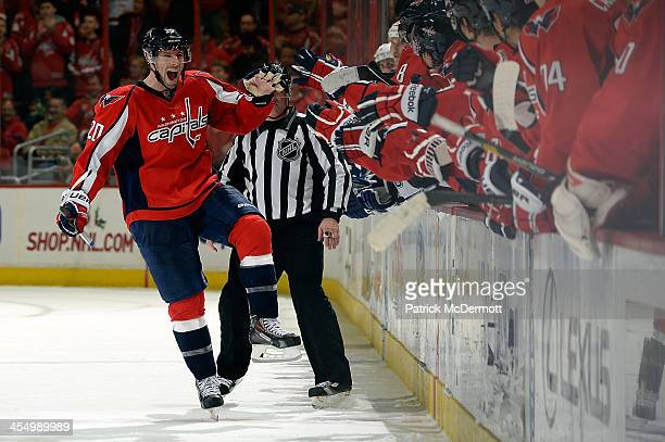 Troy Brouwer of the Washington Capitals celebrates after scoring the gamewinning goal in a shootout during an NHL game against the Tampa Bay...