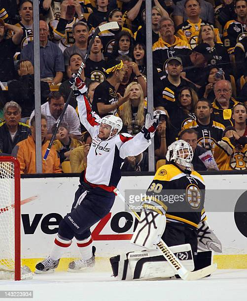 Troy Brouwer of the Washington Capitals celebrates his game winning powerplay goal at 1833 against Tim Thomas of the Boston Bruins in Game Five of...