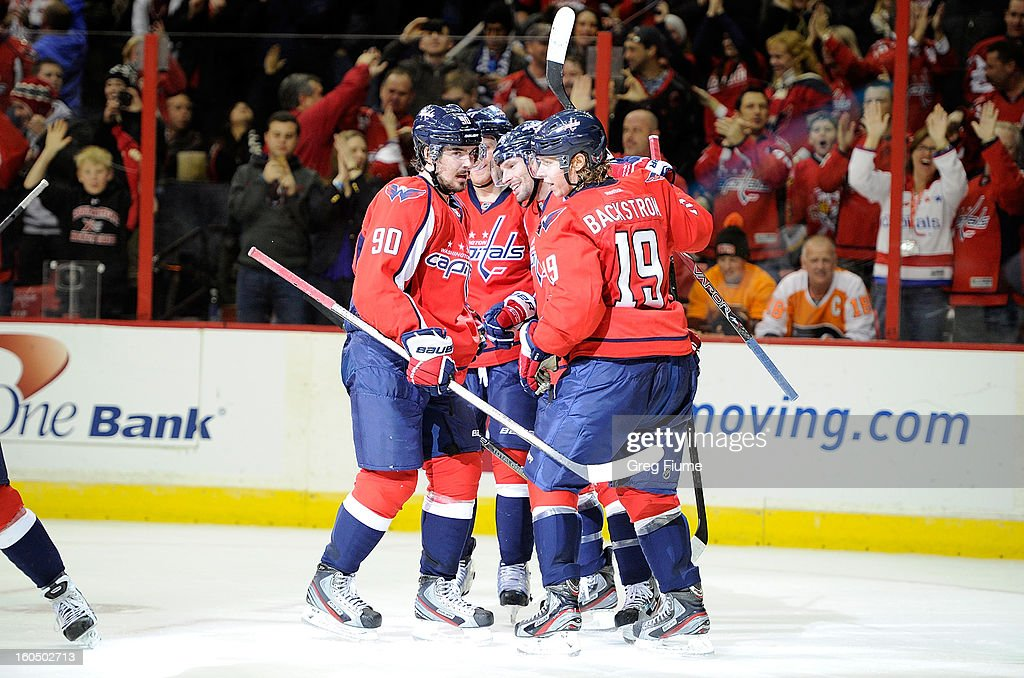 Troy Brouwer #20 of the Washington Capitals celebrates with teammates after scoring in the third period against the Philadelphia Flyers at the Verizon Center on February 1, 2013 in Washington, DC.
