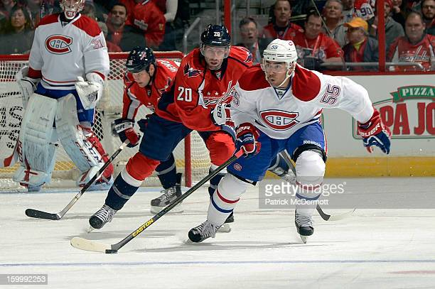 Troy Brouwer of the Washington Capitals chases Francis Bouillon of the Montreal Canadiens brings the puck up ice during the first period an NHL...