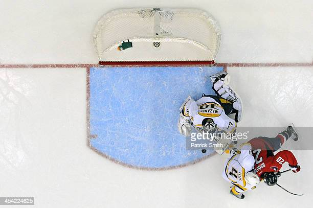 Troy Brouwer of the Washington Capitals scores past defender Ryan Ellis and goalie Marek Mazanec of the Nashville Predators in the first period...