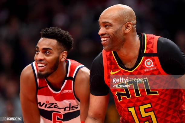 Troy Brown Jr. #6 of the Washington Wizards and Vince Carter of the Atlanta Hawks speak during the second half at Capital One Arena on March 06, 2020...