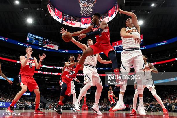Troy Brown Jr #6 of the Washington Wizards looks to pass the ball in front of Michael Porter Jr #1 of the Denver Nuggets during the first half at...