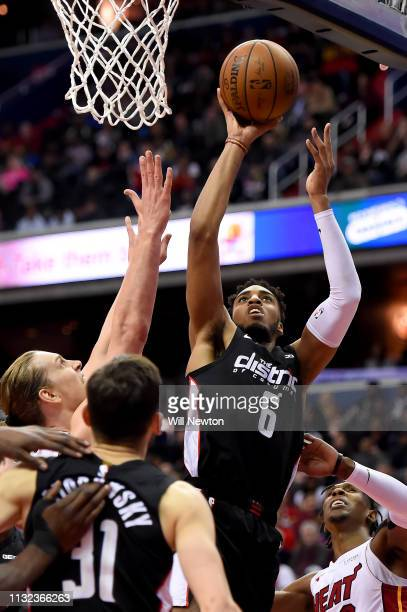 Troy Brown Jr #6 of the Washington Wizards shoots in front of Kelly Olynyk of the Miami Heat during the second half at Capital One Arena on March 23...