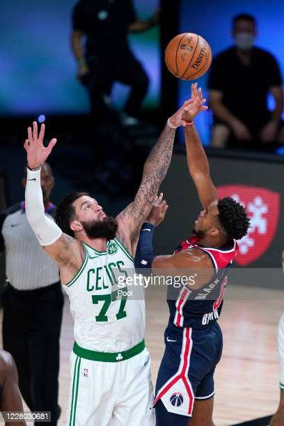 Troy Brown Jr. Of the Washington Wizards shoots over Vincent Poirier of the Boston Celtics in the second half at AdventHealth Arena at ESPN Wide...
