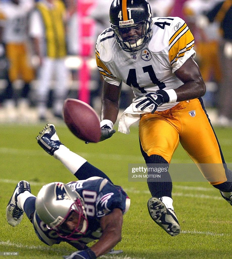 Troy Brown (L) of the New England Patriots can't get to the ball as Lee Flowers (R) of the Pitsburgh Steelers puts on the pressure in the second quarter at the new Gillette Stadium in Foxboro, Massachusetts 09 September 2002.