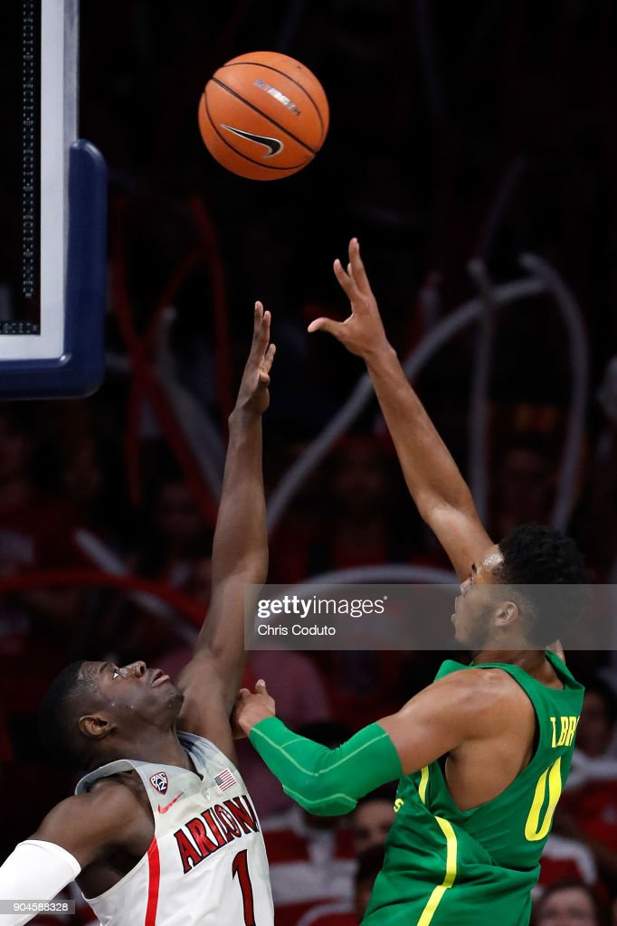 Troy Brown #0 of the Oregon Ducks shoots over Rawle Alkins #1 of the Arizona Wildcats during the second half of the college basketball game at McKale Center on January 13, 2018 in Tucson, Arizona. The Wildcats beat the Ducks 90-83.