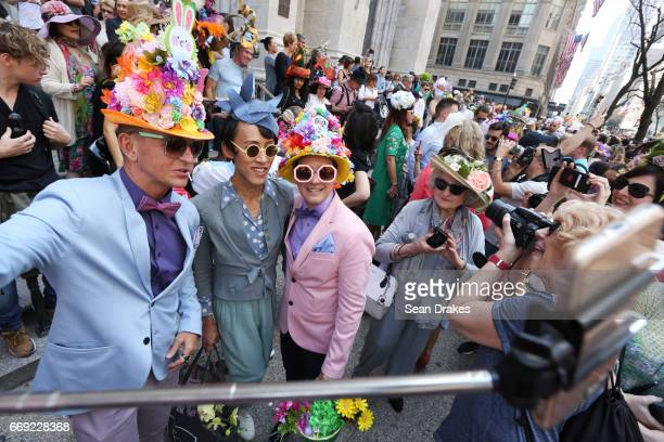 Troy Burris Voon Chew and Erhal Fornaris pose for a selfie during the Easter Parade on Fifth Avenue at St Patrick's Cathedral on April 16 2017 in New...