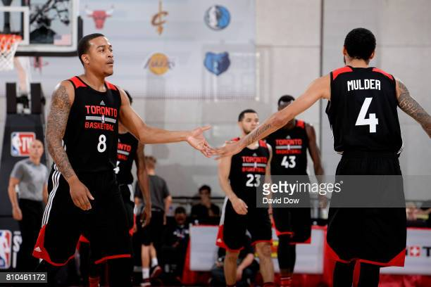 Troy Caupain and Mychal Mulder of the Toronto Raptors high five each other during the game against the New Orleans Pelicans during the 2017 Las Vegas...