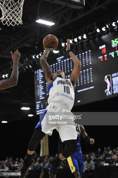 Troy Caupain of the Lakeland Magic drives to the basket against the Santa Cruz Warriors during the NBA G League Winter Showcase on December 20, 2018...