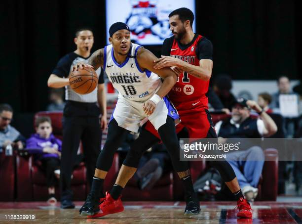Troy Caupain of the Lakeland Magic is defended by Mychal Mulder of the Windy City Bulls during the second half of an NBA GLeague game on March 1 2019...