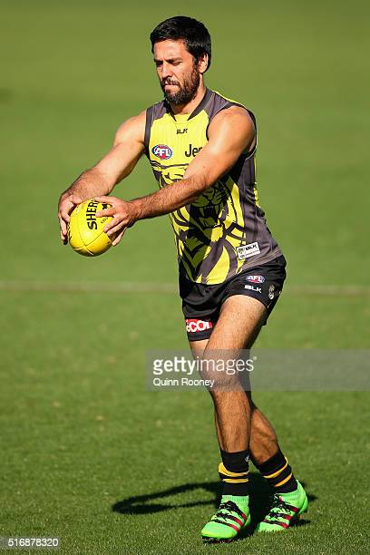 Troy Chaplin of the Tigers kicks during a Richmond Tigers AFL training session at ME Bank Centre on March 22 2016 in Melbourne Australia