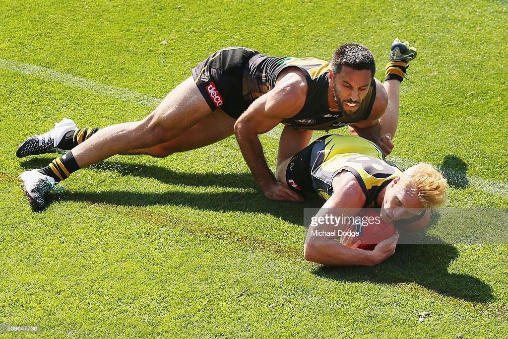 Troy Chaplin of the Tigers tackles Steven Morris of the Tigers during the Richmond Tigers AFL intra-club match at Punt Road Oval on February 12, 2016 in Melbourne, Australia.
