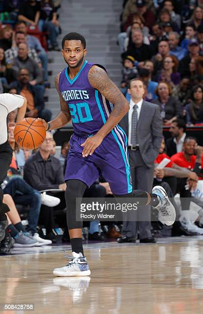 Troy Daniels of the Charlotte Hornets brings the ball up the court against the Sacramento Kings on January 25 2016 at Sleep Train Arena in Sacramento...