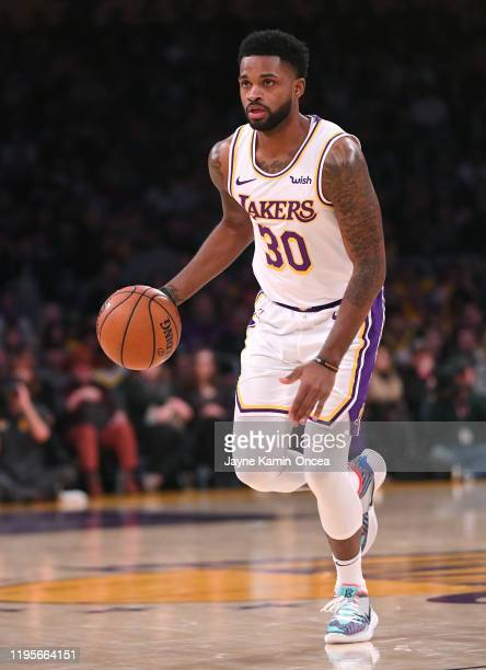 Troy Daniels of the Los Angeles Lakers takes the ball down court in the game against the Denver Nuggets at Staples Center on December 22 2019 in Los...