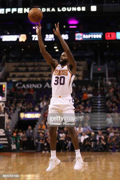Troy Daniels of the Phoenix Suns attempts a three point shot against the Toronto Raptors during the second half of the NBA game at Talking Stick...