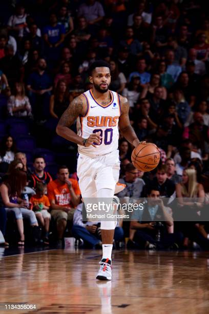 Troy Daniels of the Phoenix Suns brings the ball up the court against the Cleveland Cavaliers on April 1 2019 at Talking Stick Resort Arena in...
