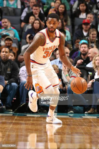Troy Daniels of the Phoenix Suns dribbles the ball during the game against the Charlotte Hornets on March 10 2018 at Spectrum Center in Charlotte...