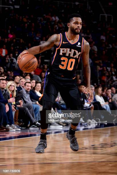 Troy Daniels of the Phoenix Suns handles the ball against the Denver Nuggets on January 12 2019 at Talking Stick Resort Arena in Phoenix Arizona NOTE...