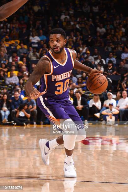 Troy Daniels of the Phoenix Suns handles the ball against the Golden State Warriors during a preseason game on October 8 2018 at ORACLE Arena in...