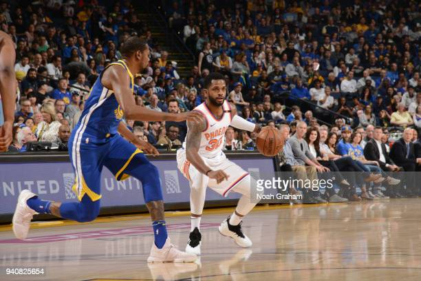 Troy Daniels of the Phoenix Suns handles the ball against the Golden State Warriors on April 1 2018 at ORACLE Arena in Oakland California NOTE TO...